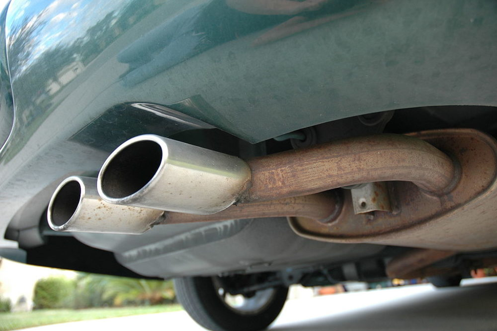 a tailpipe on a green vehicle