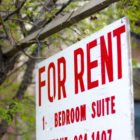 "hanging ""for rent"" sign"