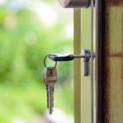 keys hang from the lock of a door