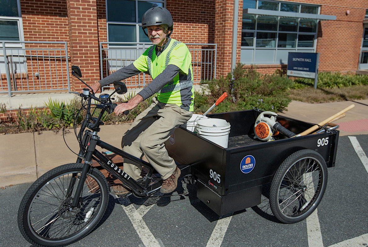 maintenance worker on cargo bike