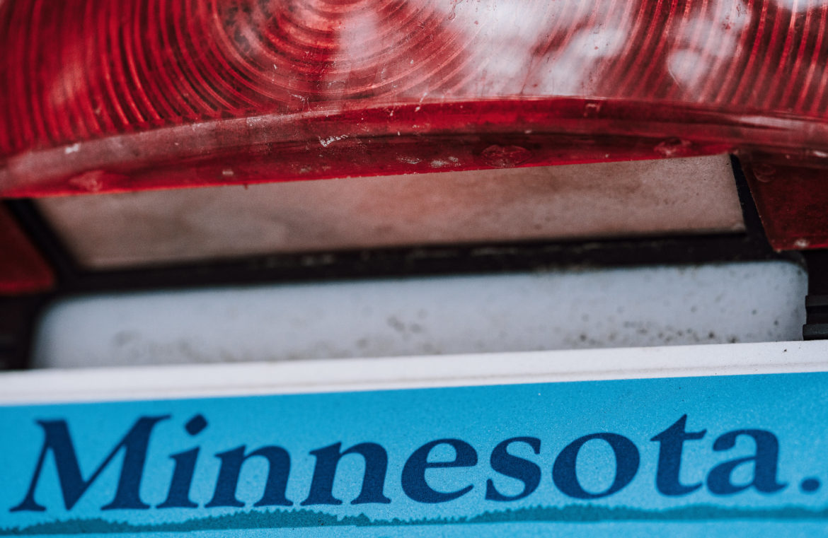 A Minnesota vehicle license tag