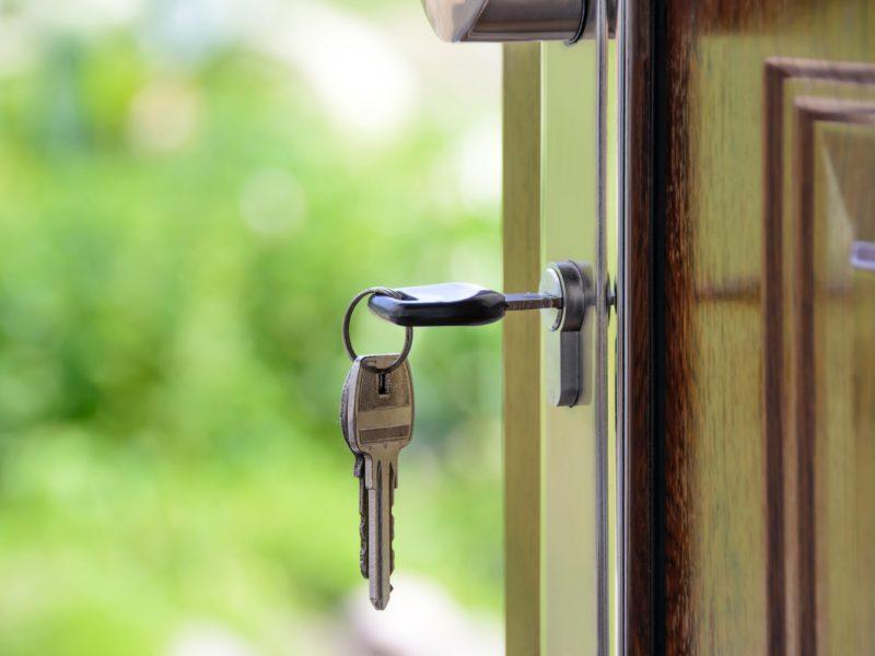 keys hang from a lock on a door