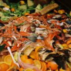 food waste piled up in a dumpster