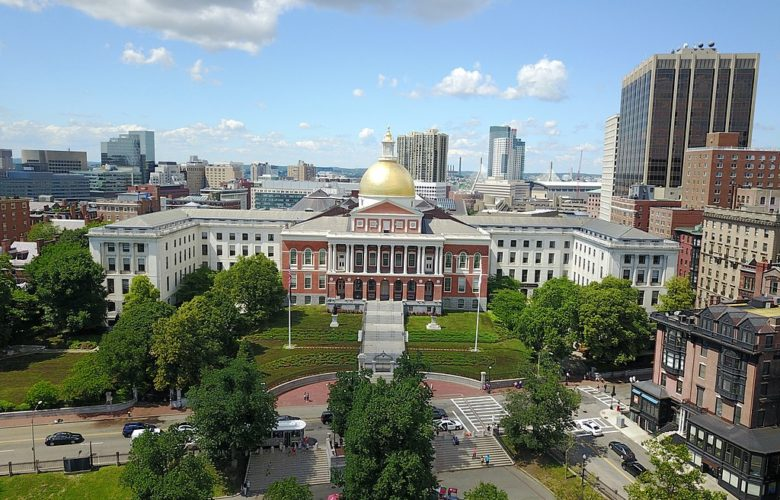 An aerial shot shows the Massachusetts State Capitol and the surrounding area.