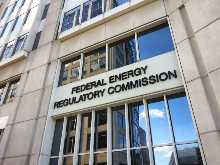 "a sign above a bank of windows: ""Federal Energy Regulatory Commission"""
