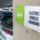 "a sign that reads ""electric vehicle charging"""