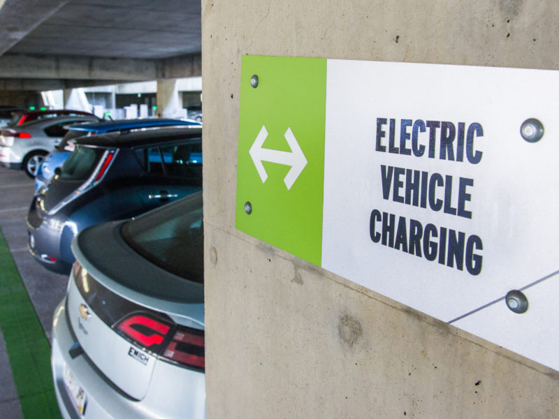 """a sign that reads """"electric vehicle charging"""""""
