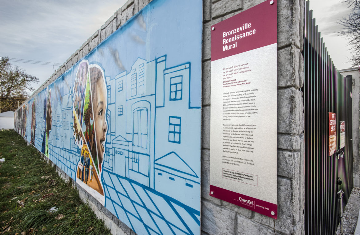 """The right half of a mural features STEM-related themes, with a sign that identifies the artwork as the """"Bronzeville Renaissance Mural"""""""