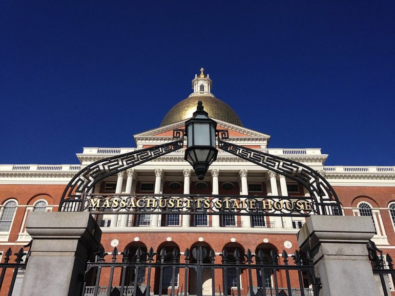 The gate outside the Massachusetts Statehouse, with the Capitol Building behind it.